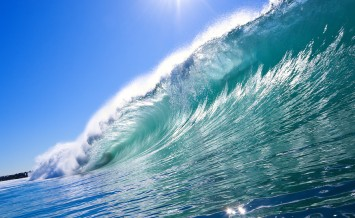 bigstock-Big-Blue-Wave-with-Sun-and-Cle-17176127