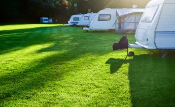 bigstock-Campsite-with-caravans-in-a-mo-38715718