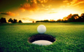 bigstock-Golf-Ball-Near-Hole-46593271