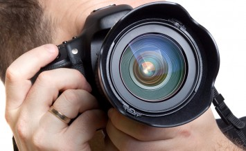 bigstock-Photographer-taking-pictures-w-38691439