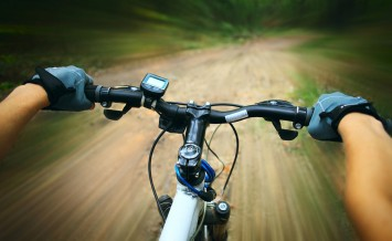 bigstock-Riding-on-a-bike-in-forest-s-p-14020292