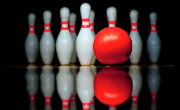 bigstock-Ten-bowling-pins-and-ball-47157838