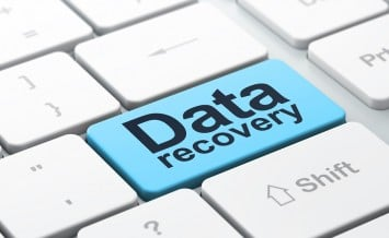 Information concept: Data Recovery on computer keyboard backgrou