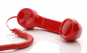 Red old fashioned telephone handset isolated on a white concept