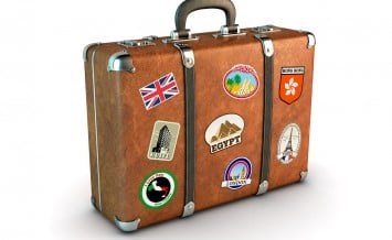Travel Suitcase with stickers. Clipping path included. Computer