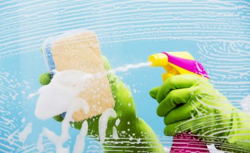 Cleaning - cleaning window pane with spray detergent, spring cle
