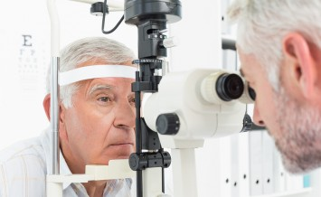 Close-up of an optometrist doing sight testing for senior patien