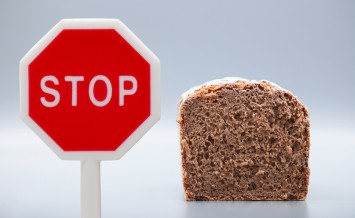 Granary Bread On Gray Background With Stop Sign