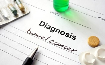 Diagnosis bowel cancer written in the diagnostic form and pills.