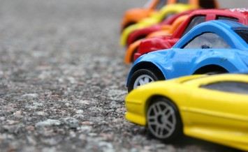 Miniature Colorful Cars Standing In Line On Road Sale Concept. D