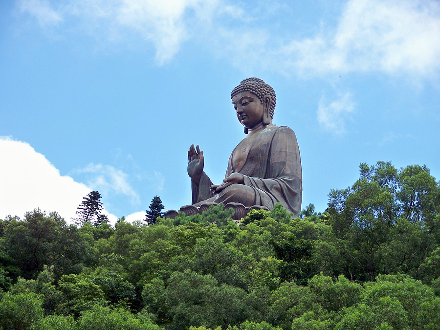 Giant statue of Tien Tan Buddha in natural surroundings on Lantau