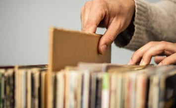 Close Up On Hands Browsing Record Storea
