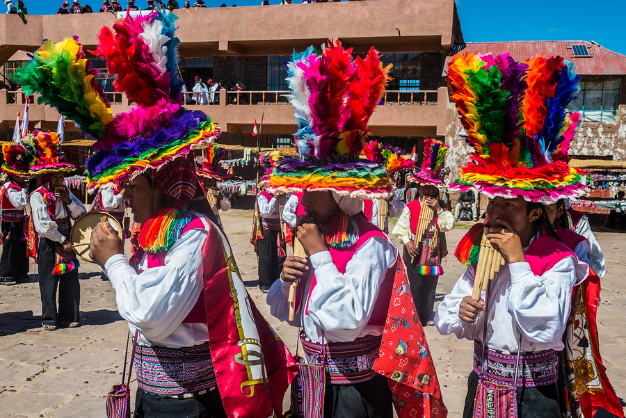 Musicians and dancers in the peruvian Andes at Taquile Island on Puno Peru