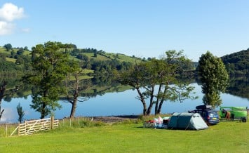 Campsite tents Ullswater Lake District Cumbria England UK with m