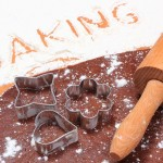 Word baking written in white flour dough for cookies and accessories for baking concept for baking