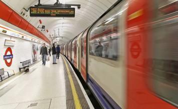 LONDON UK - November 20: Central line Liverpool Street tube station platform in London UK - November 20 2011; Metro train approaching Liverpool Street station with passengers waiting on platform