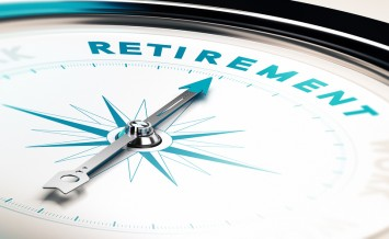 Compass with needle pointing the word retirement concept image to illustrate retirement planning