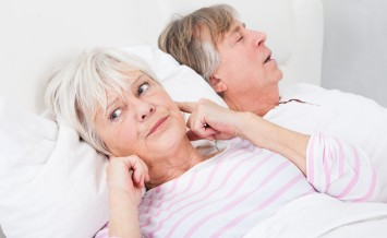 Portrait Of Senior Angry Woman Awaken By Her Husband Snoring
