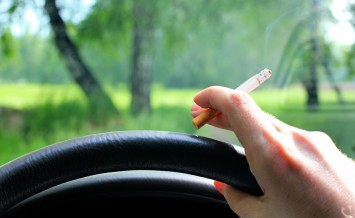 hand of the car driver with cigarette closeup