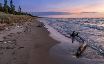 Driftwood on a Lake Huron Beach at Twilight - Grand Bend Ontario Canada