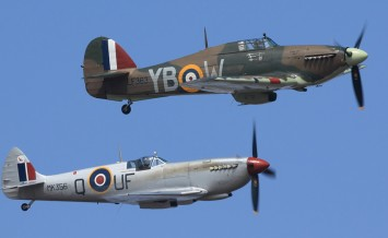 CLEETHORPES, ENGLAND - JULY 26, 2013: A Spitfire and Hurricane fly side by side to commemorate the Battle of Britain during a public airshow performance.