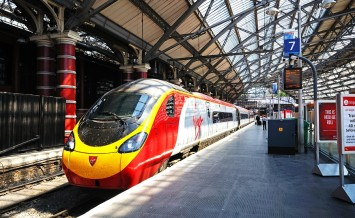 LIVERPOOL, UK - JUNE 11, 2015 - Virgin Class 390 train alongside platform seven in Lime Street Railway Station Liverpool Merseyside England UK Western Europe, June 11, 2015.