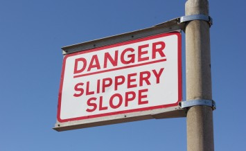 conceptual sign post with, danger slippery slope