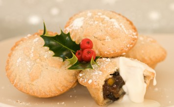 Plate of Christmas mince pies with cream