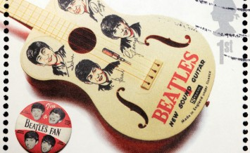 GREAT BRITAIN - CIRCA 2007: A stamp printed by Great Britain shows the Beatles memorabilia (guitar and pin) circa 2007. ** Note: Slight graininess, best at smaller sizes