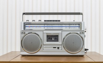 Vintage portable boom box style radio cassette player on old woo