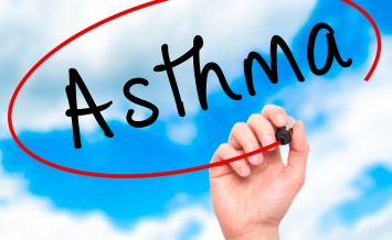 Man Hand writing Asthma with black marker on visual screen. . Business, technology, internet concept
