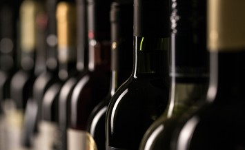 Row of vintage wine bottles in a wine cellar (shallow DOF; color