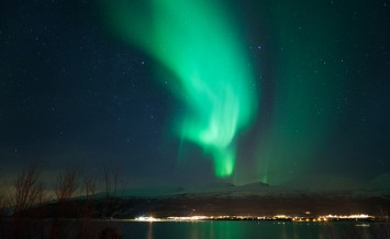 Colorful sky during a winter night in northern Norway . Northern lights dancing in the sky ** Note: Soft Focus at 100%, best at smaller sizes