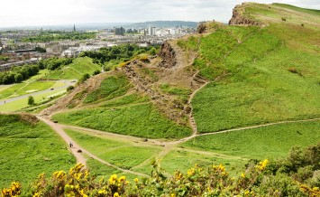 Arthur's Seat is the main peak of the group of hills which form most of Holyrood Park. It is situated in the centre of the city of Edinburgh about a mile to the east of Edinburgh Castle. The hill rises above the city to a height of 250.5 m (822 ft) provid