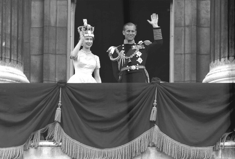 Elizabeth is officially crowned Queen on 2 June 1953, several months after the death of her father. Here she is pictured with The Duke of Edinburgh from the balcony at Buckingham Palace, following Her Majesty's Coronation at Westminster Abbey.