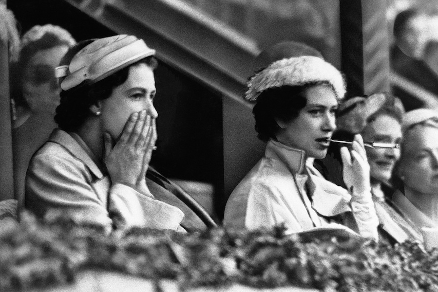 The Queen also has a keen interest in horse racing. Here Queen Elizabeth II animatedly watches the dressage at the Equestrian Olympics at Stockholm, Sweden in 1956 with her sister Princess Margaret.