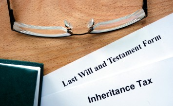 Papers with inheritance tax and testament form.