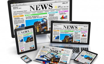 Desktop monitor, office laptop, tablet PC and black glossy touchscreen smartphones with internet web business news on screen and stack of color newspapers isolated on white background