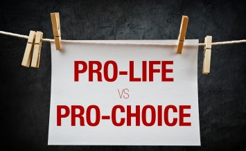 Pro-life vs pro-choice female right on abortion concept