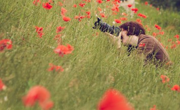 Woman Photographer Taking Photo With Camera In Nature