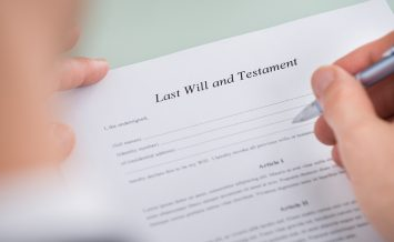 Person Hand Over Last Will And Testament Form