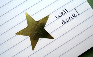 gold star sticker with words well done