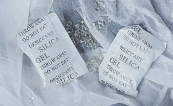 silica gel balls lay in package white paper