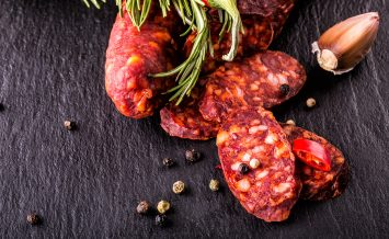 Sausage Chorizo. Spanish traditional chorizo sausage, with fresh herbs, garlic, pepper and chili peppers. Traditional cuisine.