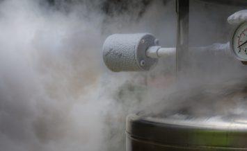 Excess smoky nitrogen gas discharge during filling of a liquid nitrogen dewar.