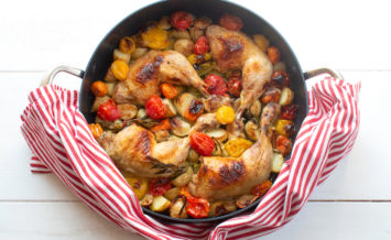 Crispy chicken legs with mixed Isle of Wight cherry tomatoes, leeks and potatoes