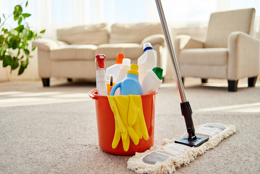 Cleaning Set For Different Surfaces In Orange Bucket And Mop On