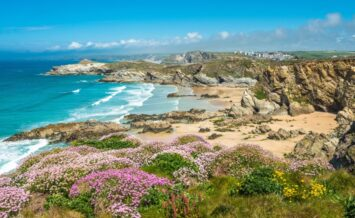 an image of Newquay Beach, Cornwall from the cliffs with a view of the coastline